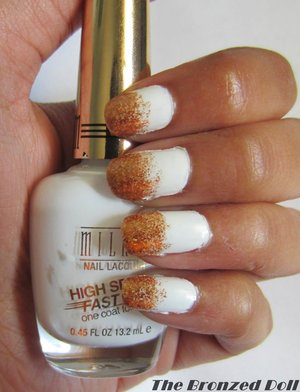 white nails with a gold glitter gradient.  http://thebronzeddoll.blogspot.com/2014/05/notw-white-with-gold-glitter-gradient.html?m=1