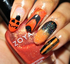 I know I'm a bit late, but Happy Halloween everyone!! These are my nails for this week's #busygirlnails challenge, orange! All of the nail polishes I used were: Orly Shine On Crazy Diamond, Wet n Wild The Clock Strikes Orange, Wet n Wild Sunny Side Up, Sally Hansen Black Out, Zoya Gabrielle, & Maybelline Twilight Rays.