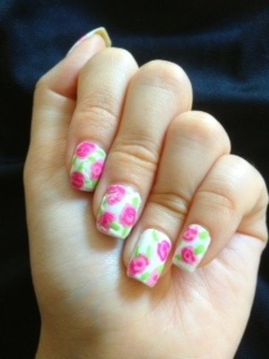 Hi! I tried this kind of floral nail art for once. It was easier than I thought it would be. It isnt that neat though. But I think it is great for summer :D