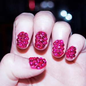 It was requested a while back on my tumblr (http://therealglitterface.tumblr.com/) that I do a 'Raspberry Nails' look as a sequel to my 'Blackberry Nails'. I thought it was a great idea so I gave it a go! It took me a while to find the right kind of rhinestones that were rounded on top instead of being angular like most rhinestones. In the end I actually found these in a wedding invitation suppliers! haha, you just never know how or where these things will pop up :) I also went with my natural nails for this one, I thought it would look cuter. Hope you like em! GFx