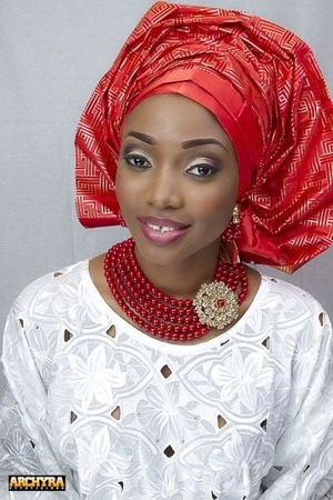 Nigerian bridal look,red beads with brooch..