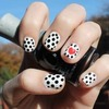 Black and white polkadots with a red heart accent