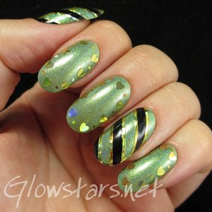 Read the blog post at http://glowstars.net/lacquer-obsession/2014/11/green-holo-stripes-and-hearts/