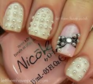 okay so get nicole light pink color or any color and get white nail polish then get nail glue and half of pearls then get tweesers and start gluing them on