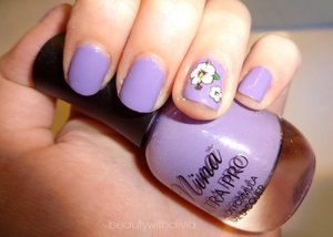 I'm so loving this color! It's called lilac-ing discipline. Even though it's not the color of real lilacs, it's still gorgeous.