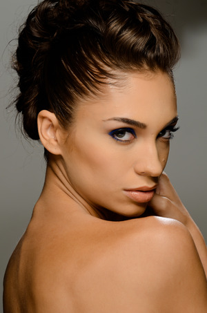 up do: cage braid with teased hair, to give body contoured make up with bright blue eye shadow