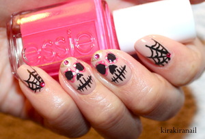"""♡ Tutorial: http://youtu.be/MrvUAsa8rrY  ♡ My inspiration for this design: http://www.beautylish.com/f/gpsmvi/sugar-skull   Products I used: """"Same Seine But Different"""" (Nr. 070) by Catrice Nr. 79240- 711 by LCN (gold) """"black"""" by L.A. Colors, Art Deco """"Status Symbol"""" (Nr. 26) by Essie (pink) Colorful Nails Nr.01 by Canmake Rhinestones: 100 Yen Shop Base and top coat"""
