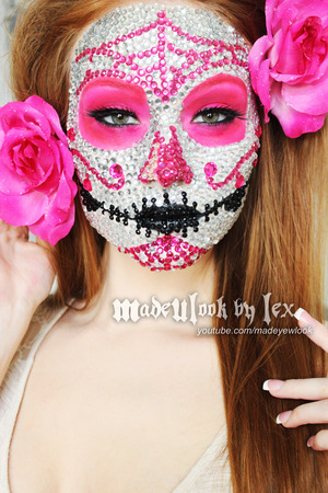 http://www.youtube.com/watch?v=HkRse7SqS5U A fresh look on a commonly done Sugar Skull. Hey, I HAD to give you guys at least a one tutorial break from the scary stuff, right?! This look required 800 rhinestones, and three hours to be done. If you plan on recreating this look for your halloween event, or to celebrate Day of the Dead, be sure you give yourself PLENTY of time to do it. MadeULook Halloween Tutorials 2013.