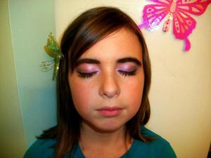 A soft, fluttery look inspired by the fantasies and dreams of butterflies.  Keep the rest of the face natural with a hint of a glow in the cheeks (use a rosy blush). Prime the eyes, and apply a light, shimmery pink allover the lid - I used Mica Bella's Sunrise. Further into the crease, go darker with a shimmery royal blue - I used Mica Bella's violet. Thinly line the eye with black eyeliner winging it out towards the temples. Finish with a couple coats of mascara.