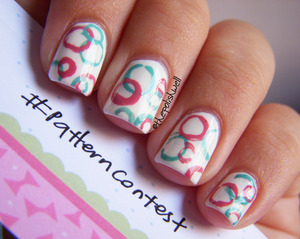 For more details on how to create this look using a straw: http://thepolishwell.blogspot.com/2012/07/nail-ideas-fun-retro-circles.html