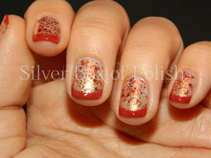 Festive glitter nails with red French tips.
