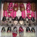 Pink leopard & spiked black holo stiletto nails