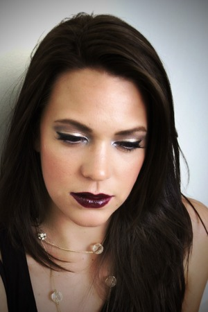 A holiday look using gold and silver pigments and a deep burgundy lip
