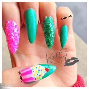 Long stiletto nails with cupcake and glitter