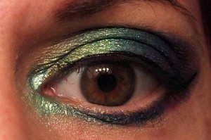 Sugarpill Inner lid and crease inner to outer: Lumi over Absinthe, Absinthe, Tipsy, Darling, Royal Sugar. Outer V is 2 a.m. around Poison Plum around Elemental Chaos. Lower lash line inner to outer is Lumi over Absinthe into Tipsy, Royal Sugar, Poison Plum. I learned that Sugarpill shadows are a bit more saturated than other LOOSE shadows, are on the dark side (having white to blend with is a good idea), and go very well with one another. I am wearing eight.