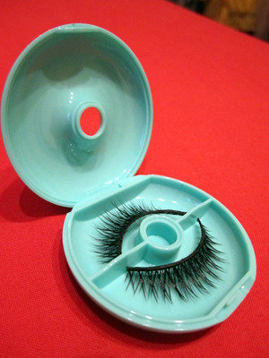 Ingenious! Now I don't have to worry about crushing my beloved lashes while I pack for travel.