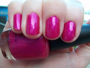 OPI Flashbulb Fuchsia Nail Polish.  To read my review of this polish please visit my blog:   www.mazmakeup.blogspot.com
