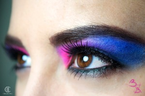 Just basic color blocking. Used my crown brush palette for the pink and purple. Estee Lauder eyeshadow base. Estee Lauder Onyx DoubleWear Eyepencil. Ardell lashes. Victoria Secret Mascara... Cheap but awesome!!!!