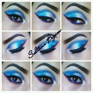 Dramatic blue glitter eyes with red underline