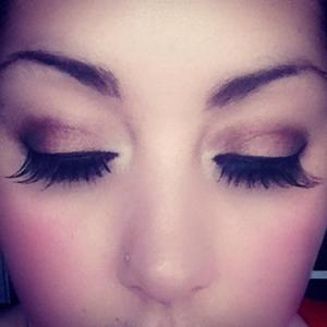 A warm smoky eye, using browns and red cherry false lashes.
