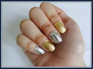 Hello all! I used silver and gold aluminum or tin tin foil to do my nails. I do know that this is a different design. Not everyone can appreciate it. I got my inspiration from the may issue of Her world magazine and I decided to try something new. (: I have a video on how I did this.