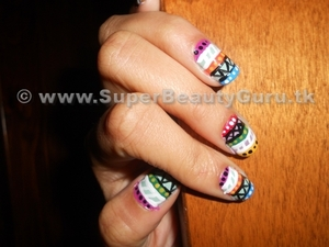 Tutorial here: http://bit.ly/x7wsIf  Tribal print nails!