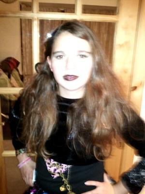 me at haloween dressed as a dead angel. i did hav black halo but it broke :-(