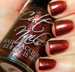 A shiny Copper penny shimmer with flashes of Pink.  Behind Closed Doors Collection