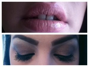 Dark brown eyeshadow, big lashes, and nude lipgloss on top of nude lipstick.