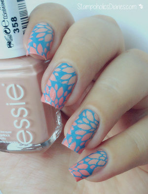 http://stampoholicsdiaries.com/2015/07/03/floral-nail-art-with-essie-mundo-de-unas-and-messy-mansion/