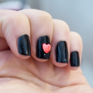 I found these cute little red heart shapes in my jewelry box and thought they would be perfect for nail art so I made this simple look with them :) I'm not one to get all mushy about Valentines day or romance in general, but this I could manage! GFx