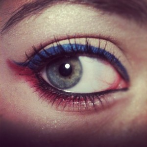 This is a very soft WEARABLE makeup look for the fourth of july. I used a red lipstick on my lower lashline and set it with a hot pink blusher.
