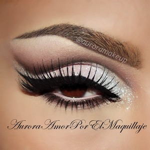 1) Jumbo pencil in MILK as a base from #NYXcosmetics 2) Apply white matte e/s WHITE from #NYXcosmetics 3) Mark the crease line higher than natural you have w/ dark brown e/s from palette ELF 144 #ELFcosmetics 4) Blend the line done w/ dark wine matte e/s from same ELF palette 144 5) Place lashes adhesive DUODUO on the mobile eyelid & extend it as outer wing  6) Apply white glitter above adhesive placed, I used one from #GELDENcosmeticos 7)Take a baby pink pigment & place it over the outer mobile eyelid , I choose No.15 #BISSUcosmetics 8) Line your top lashes w/ black gel liner, 01 from #ADARAparis 9) Add dramatic lashes No. 72 from #CREME 10) Line waterline w/ matte highlight pencil from #AnastasiaBeverlyHills in PINK 11)Line your lower lashes w/ brown-copper shadow from same ELF palette 144 12) Tap some bright white pigment on the inner corner & mobile eyelid. I used SE-08 from #ADARAparis. You can see swatches of this product on my Youtube videos I use it frequently. The pages of the products are: anastasia.net nyxcosmetics.com elfcosmetics.com thecremeshop.com adaraparis.com geldencosmeticos.com THANK U GORGEOUS !!! ENJOY YOUR DAY!