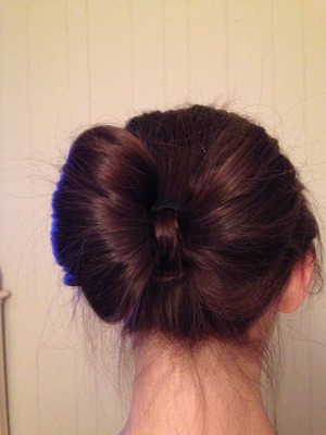 I did this bow bun to myself without any products or a mirror.  What do you guys think?