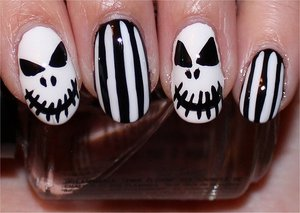 See more swatches & my step-by-step tutorial here: http://www.swatchandlearn.com/nail-art-tutorial-jack-skellington-nails-nightmare-before-christmas-nails/