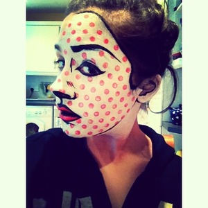 Inspired by some of Roy Lichtenstein's art work, my first attempt, painted again on Jordan's face. Black and white face paint, and coral red lipstick (used for lips and red dots).