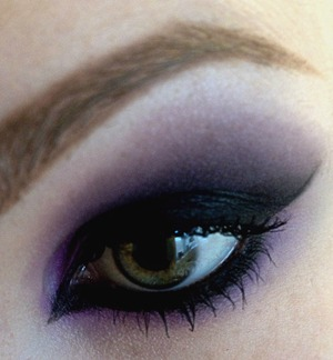 Apply a purple eyeshadow all over, past the crease, about halfway up to your eyebrows and underneath about a cm out from your lower lash line. Use a black eyeshadow over the top stopping just before the purple ends. Blend blend blend. Apply nude eyeshadow under your eyebrows to highlight and to make sure the purple is blended nicely. Giant cat eye, scouse brows, mascara, done!