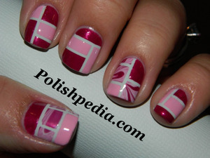 Do you love water marbling?  Do you love color blocking?  The two are now one. !  See more and the products that were used @ http://polishpedia.com/water-marbled-color-blocking.html