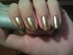 Luxe. From ORLY. It's a foily gold, it's not chrome at all (sadly) but I love it all the same. It reminds me of Passion by China Glaze but it's not as warm toned. It's like a silvery gold.
