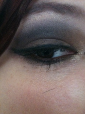 close up of sophia loren look with Lancome 's chic and Fashion label e/s and MAC carbon, vanilla e/s and fluidline in blacktrack and UD burbon 24/7 liner in the waterline