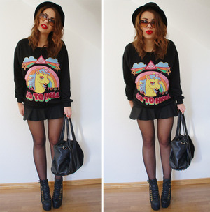 Black sweatshirt, featuring round neck, Go TO HELL, rainbow and unicorn print in front, long sleeves, soft touch fabric. This leisured sweatshirt goes great with denim hot shorts when having a date with boyfriend.