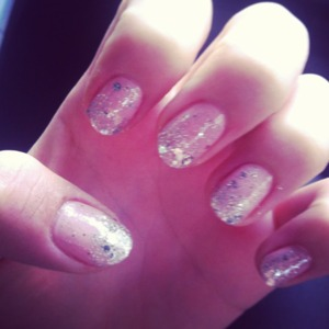 silver glitter and nude pink nail polish