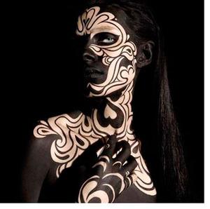 alex box makeup artist, avant garde, black face paint, intricate face paint