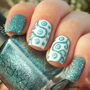 More pictures: http://www.beautybysuzi.blogspot.sk/2014/01/ornamental-nail-design.html Tutorial: http://www.youtube.com/watch?v=5wM9QbkSL14&feature=player_embedded Used nail polishes: Gabriella Salvete Calcium Gabriella Salvete Enamel With Hardener, 148 Gabriella Salvete STARS Enamel, 06 Acquamarina NYC Get Up to Sped! Turbo Dry Top Coat