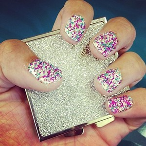Multi Colored Nail Pearls on White Nail Polish to give that sprinkle effect!