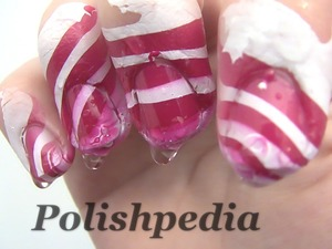 I was having fun with doing Candy Canes using the water marbling technique!  Watch The Video Tutorial @ http://www.polishpedia.com/candy-cane-nail-art.html