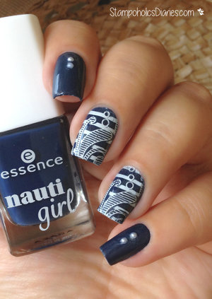 http://stampoholicsdiaries.com/2015/06/16/nautical-nails-with-essence-cicisisi/