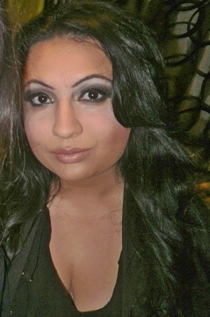 Black, dark brown and gold pigment smokey with full contoured face & Long Wavy hair by using Velcro Rollers