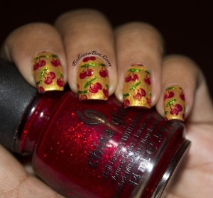 A stamped design http://www.bellezzabee.com/2013/05/nail-challenge-day-19-favorite-polish.html