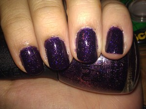 I love glitter. This is just so... beautiful. So painfully beautiful. It's a dark purple with holographic glitter in it. Nubar Purple Rain. The coverage and formula is good but even if it wasn't, I'd still love it.
